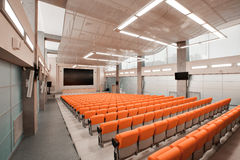 Empty chairs in theatre or conference hall. Orange color Royalty Free Stock Image