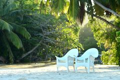 Empty chairs at the tropical beach Stock Photos