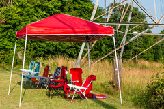 Empty Chairs Under Red Awning stock photo