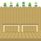 Empty Chairs On Wood Wall And Ground With Pot Plants Above Stock Photo