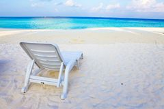 Empty chaise lounge before ocean.  stock photography