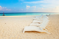 Empty chaise lounge before ocean, sunrise Royalty Free Stock Photo