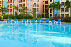 Empty chaise lounges near  pool Stock Photos