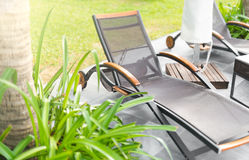Empty chaise lounges on tropical resort. Royalty Free Stock Image
