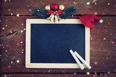 Christmas background with empty chalk board royalty free stock photography