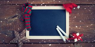 Christmas background with empty chalk board royalty free stock photos