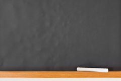 Empty chalkboard with chalk Royalty Free Stock Photo
