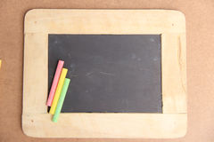 Empty chalkboard for copy space with colorful pieces of chalk. Empty chalkboard for copy space with colorful of chalk royalty free stock photo