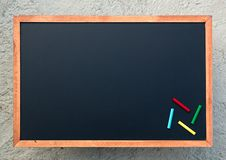 Empty chalkboard texture with colorful chalks,. image for background. Wallpaper and copyspace. bill board wood frame for add text stock images