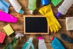 Empty chalkboard with variety house cleaning product Stock Photos