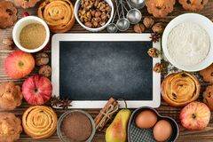 Empty chalkboard for writing recipes. And ingredients for baking, top view Royalty Free Stock Image