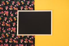 Empty chalkboard on yellow background with copy space. stock photos