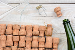 Empty Champagne Bottle and Corks stock photo