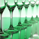 Empty champagne glasses. On a green background Royalty Free Stock Image
