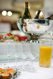 Empty champagne glasses and finger food on festive wedding table Royalty Free Stock Photo