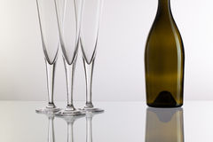Empty champagne glasses on the glass desk Stock Images