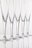 Empty champagne glasses on the glass desk Stock Image