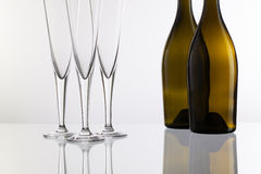 Empty champagne glasses on the glass table Stock Image