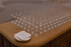 Empty champagne glasses on a marble table Royalty Free Stock Images