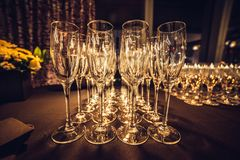 Empty champagne glasses in row on evening event party waiting for the guests. stock photos