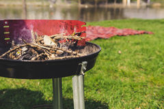 Empty charcoal grill with smoke closeup. Barbecue outdoor. Royalty Free Stock Image