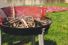 Empty charcoal grill with smoke closeup. Barbecue outdoor. Stock Photography