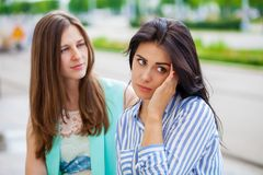 Empty chatter from which the head hurts. Two young women talking on the street stock photos
