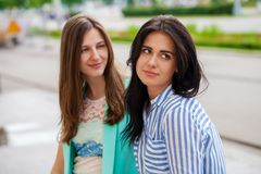 Empty chatter from which the head hurts. Two young women talking on the street stock image