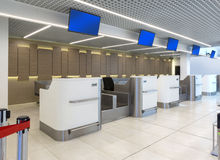 Empty check-in desks with computers Royalty Free Stock Photo