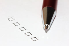 Empty checkboxes with pen pointing down Royalty Free Stock Image
