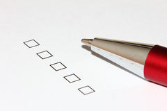 Empty checkboxes with pen pointing up. Unfilled survey question with empty checkboxes. With pen pointing up Stock Photography