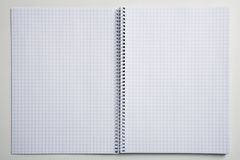 Empty checked notebook. A photo of an empty spiral notebook Stock Photos