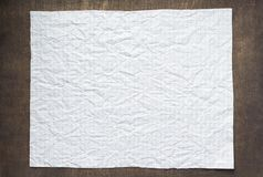 Empty checked wrinkled paper at wood stock images