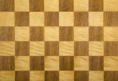 Empty chess board. Old wooden chess board chequer pattern royalty free stock images