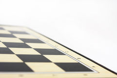 Empty chess board on the white background Royalty Free Stock Photography
