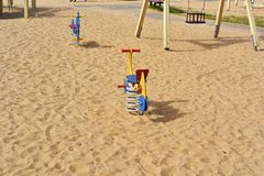 Empty child playground. Empty child playground on sand. Spring abstract photo Royalty Free Stock Photos