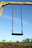 An empty child's swing. Stock Photo
