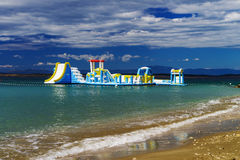 Empty children attraction in the sea, stormy weather on the beac Royalty Free Stock Photography