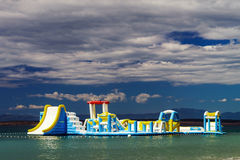 Empty children attraction in the sea, stormy weather on the beac Stock Image