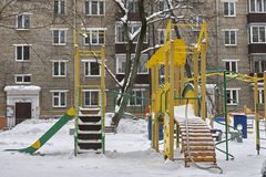 Empty children playground in Moscow courtyard in winter. Empty children playground in Moscow courtyard in snowy winter Stock Images