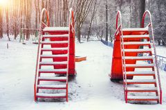 Empty children playground in winter day Royalty Free Stock Image