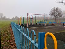 Empty playground on a misty morning royalty free stock photo