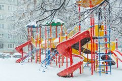 An empty children`s playground in the courtyard stock images