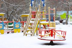 Empty children`s playground in snow Royalty Free Stock Photography