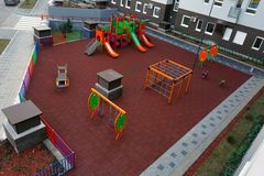 An empty children`s playground is waiting for children. The early spring morning royalty free stock image