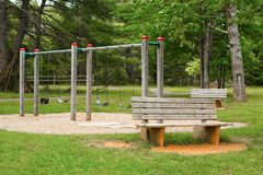 Children`s Swing Set. Empty children`s swing set in rural park royalty free stock images