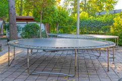 Empty children`s trampolines in a public park stock photography