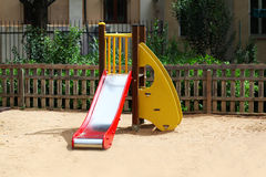 Empty childrens playground in the yard Stock Photos