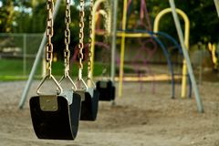 Empty childs swing set Stock Images