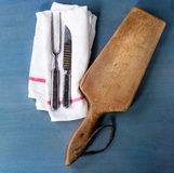Empty chopping board with cutlery Stock Images